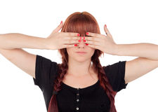 Teenage girl dressed in black with a piercing covering her eyes Stock Image