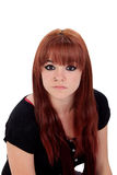 Teenage girl dressed in black with a piercing looking at camera Royalty Free Stock Photos