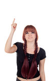 Teenage girl dressed in black with a piercing looking up Stock Images