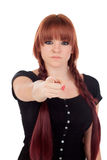 Teenage girl dressed in black with a piercing pointing at camera Royalty Free Stock Photography