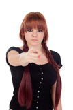 Teenage girl dressed in black with a piercing pointing at camera Royalty Free Stock Images