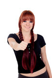 Teenage girl dressed in black with a piercing saying Ok Royalty Free Stock Photography