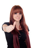 Teenage girl dressed in black with a piercing saying Ok Royalty Free Stock Photos