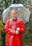 Teenage girl dressed for rainy day. Teenage girl dressed for rain in red raincoat Royalty Free Stock Images