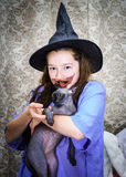 Teenage girl dressed in witch costume Stock Photography