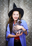 Teenage girl dressed in witch costume Stock Photos
