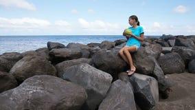 Teenage girl drinking coconut juice stock video footage