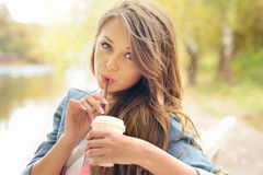 Teenage girl drinking coffee outdoor. Stock Photos