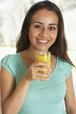 Teenage Girl Drinking Fresh Orange Juice Royalty Free Stock Photo
