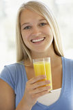 Teenage Girl Drinking A Glass Of Orange Juice Stock Images