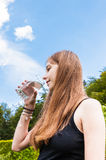 Teenage girl drinking a glass of water Stock Photo