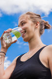 Teenage girl drinking a glass of water Stock Images