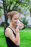 Teenage girl drinking a glass of water Royalty Free Stock Images