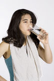 Teenage girl drinking water Stock Photos