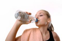 Teenage girl drinking water from bottle after Trening Stock Photo