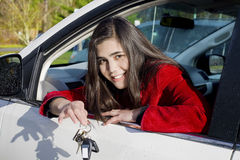 Teenage girl in driver's seat holding keys royalty free stock photos