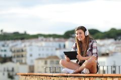 Teenage girl e-learning looking at camera royalty free stock photography
