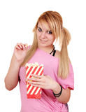 Teenage girl eat popcorn Royalty Free Stock Images