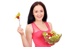 Teenage girl eat salad Stock Images