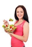 Teenage girl eat salad Stock Photo