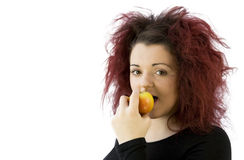 Teenage girl eating an apple Stock Photography