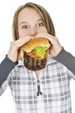Teenage girl eating big hamburger Stock Photo