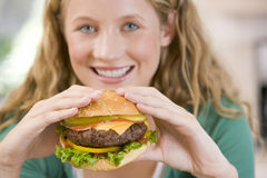 Teenage Girl Eating Burgers. Close Up Of A Teenage Girl Eating Burgers royalty free stock photo
