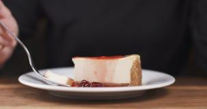 Teenage girl eating cheesecake with strawberry jam Stock Photos