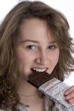 Teenage Girl Eating Chocolate Stock Photo