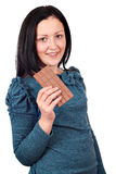 Teenage girl eating chocolate Royalty Free Stock Photos