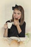 Teenage girl eating chocolate spread Royalty Free Stock Photo