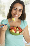 Teenage Girl Eating Fresh Fruit Salad Royalty Free Stock Photos