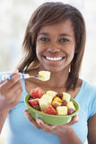 Teenage Girl Eating Fresh Fruit Salad Royalty Free Stock Photography