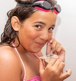 Teenage Girl. Eating. Googgles. Swimming. Indoor. Pudding stock photo