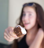 Teenage girl eating an ice cream bar Royalty Free Stock Image