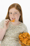 Teenage Girl Eating Nachos Stock Image