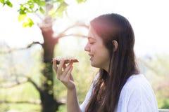 Teenage girl eating rye bread with beetroot cream Stock Photos