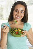 Teenage Girl Eating A Salad Stock Image