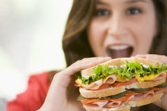 Teenage Girl Eating Sandwich Royalty Free Stock Photography