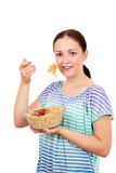 Teenage girl eating spaghetti Stock Photos