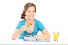 Teenage girl eating a toast and salad Royalty Free Stock Photography