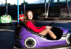 Teenage girl in an electric bumper car Royalty Free Stock Photos