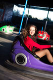 Teenage girl in an electric bumper car Stock Image