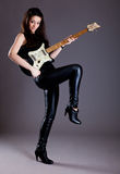 Teenage girl with electric guitar Royalty Free Stock Photography