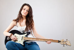 Teenage girl with electric guitar Stock Images