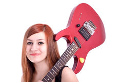 Teenage girl with an electric guitar on white back Stock Photos