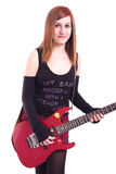 Teenage girl with an electric guitar on white back Royalty Free Stock Images