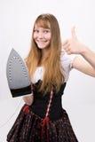 Teenage girl with electric iron Stock Photo