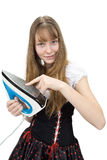 Teenage girl with electric iron Stock Images
