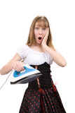 Teenage girl with electric iron Royalty Free Stock Image